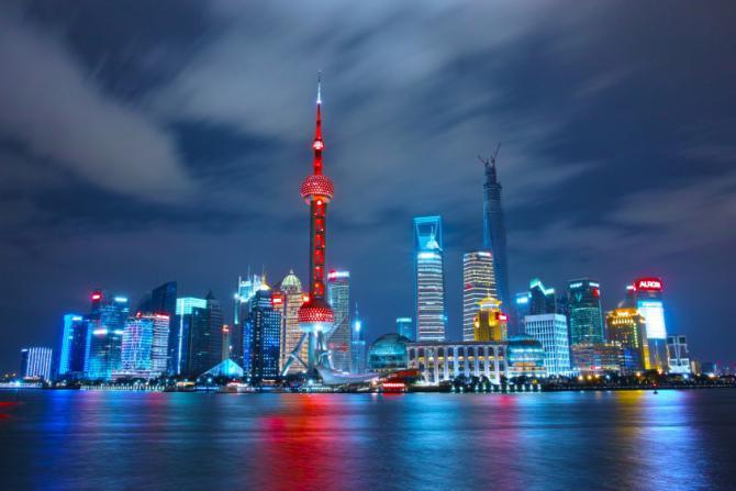 night-skyline-with-bright-lights-in-shanghai-china.jpg
